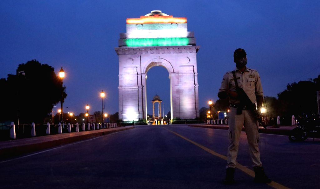 India Gate illuminated in tricolor on the eve of the 74th Independence Day in New Delhi on Aug 14, 2020.