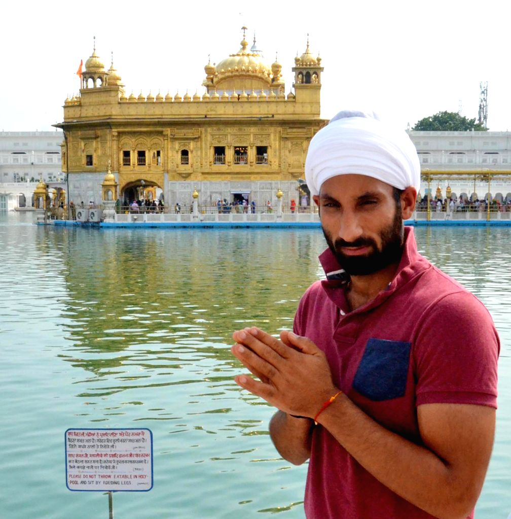 India hockey captain Sardar Singh pays obeisance at the Golden Temple in Amritsar on Aug 11, 2014.