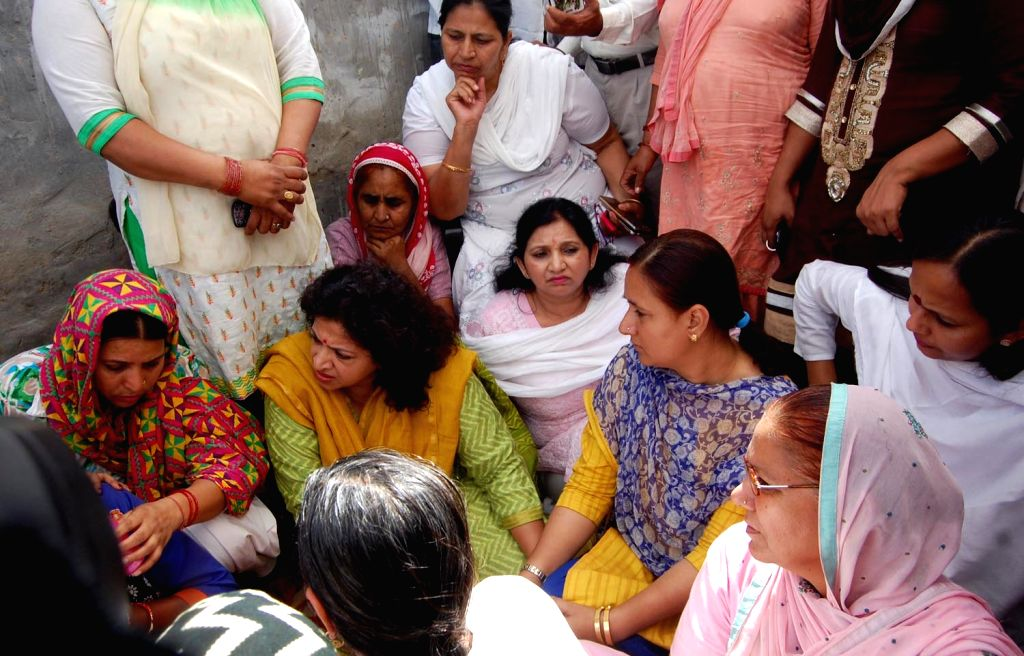 India Mahila Congress president Shobha Oza meets the family members of  the victim of Sonepat gangraape case on May 14, 2017. The Haryana Police have arrested two persons after a young woman ...