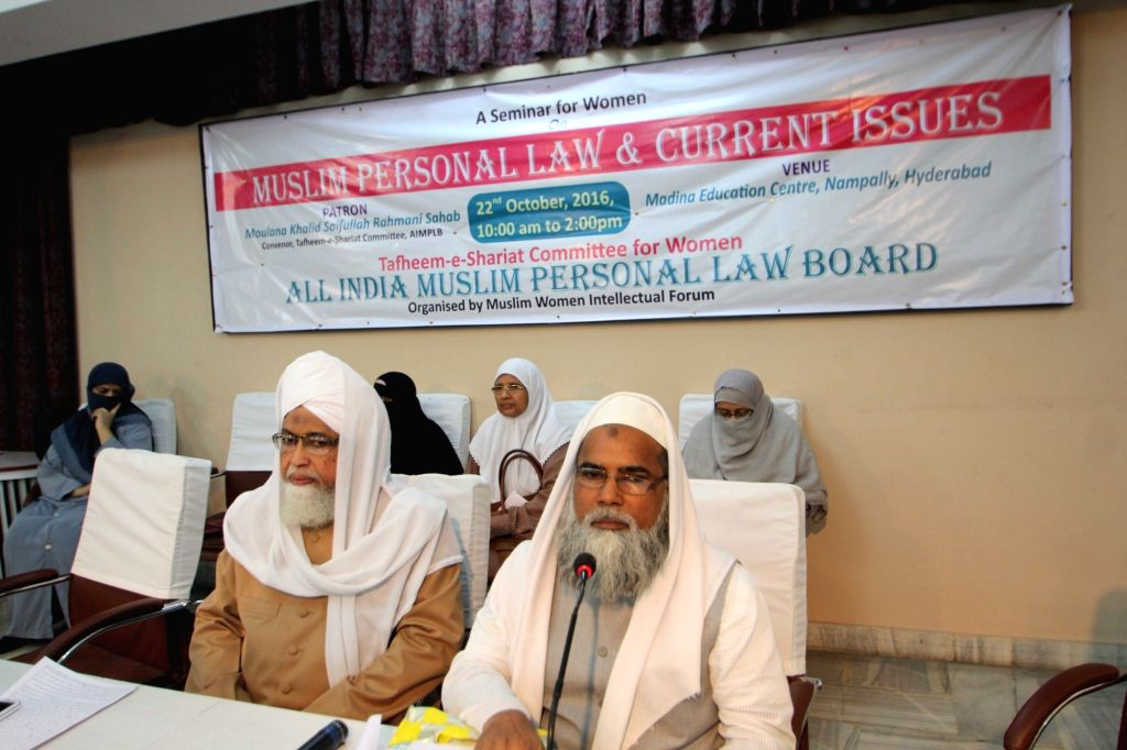 India Muslim Personal Law Board (AIMPLB) secretary Maulana Khalid Saifullah (R) addresses womens wing of Tafheem-e-Shariat committee for women's in Hyderabad on Oct 22, 2016.