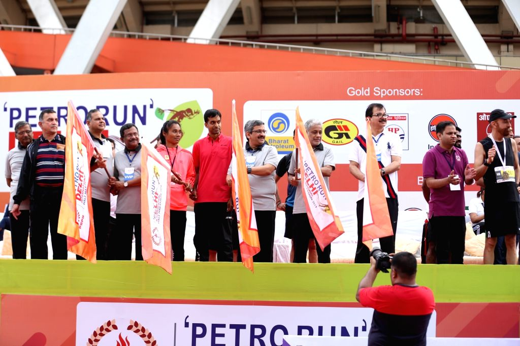 India national badminton chief coach Pullela Gopichand, sprinter Hima Das and PSPB chairman MM Kutty and president Sanjiv Singh flagg off the PSPB International Half Marathon 'Petro Run' ... - Sanjiv Singh