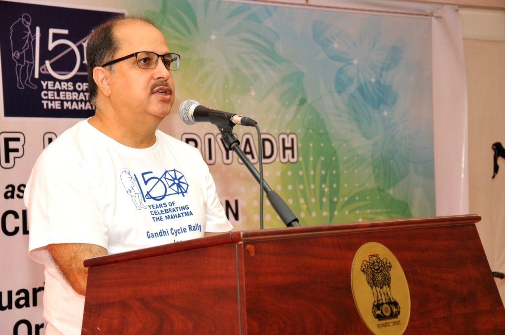 India's Ambassador to India Ausaf Saeed addresses at Gandhi cycle rally for peace in Riyadh.