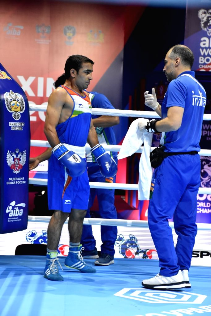 India's Amit Panghal getting last minute instructions from coach Santiago Nieva during his round 2 bout at the AIBA Men???s World Championships in Ekaterinburg, Russia on Sep 14, 2019.