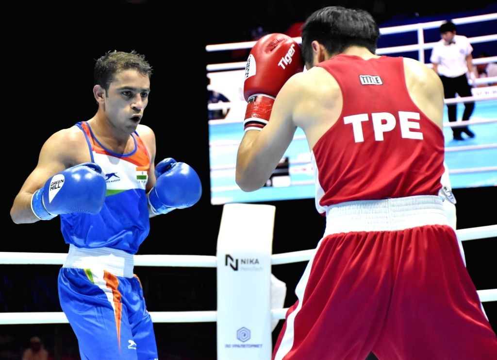 India's Amit Panghal in action against China's Tu Po-Wei during round of 16 at the AIBA Men???s World Championships in Ekaterinburg, Russia on Sep 14, 2019.