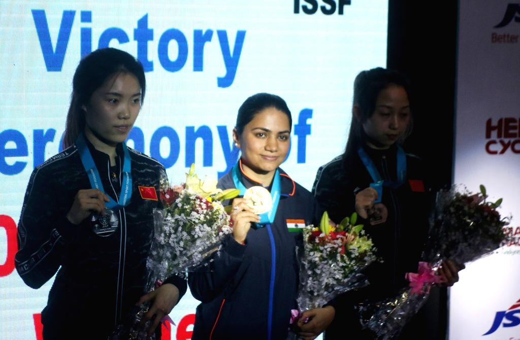 India's Apurvi Chandela (Centre), who won the first gold for India at the ISSF World Cup by finishing on top of the women's 10 metre Air Rifle category, in New Delhi on Feb 23, 2019. Zhao ...