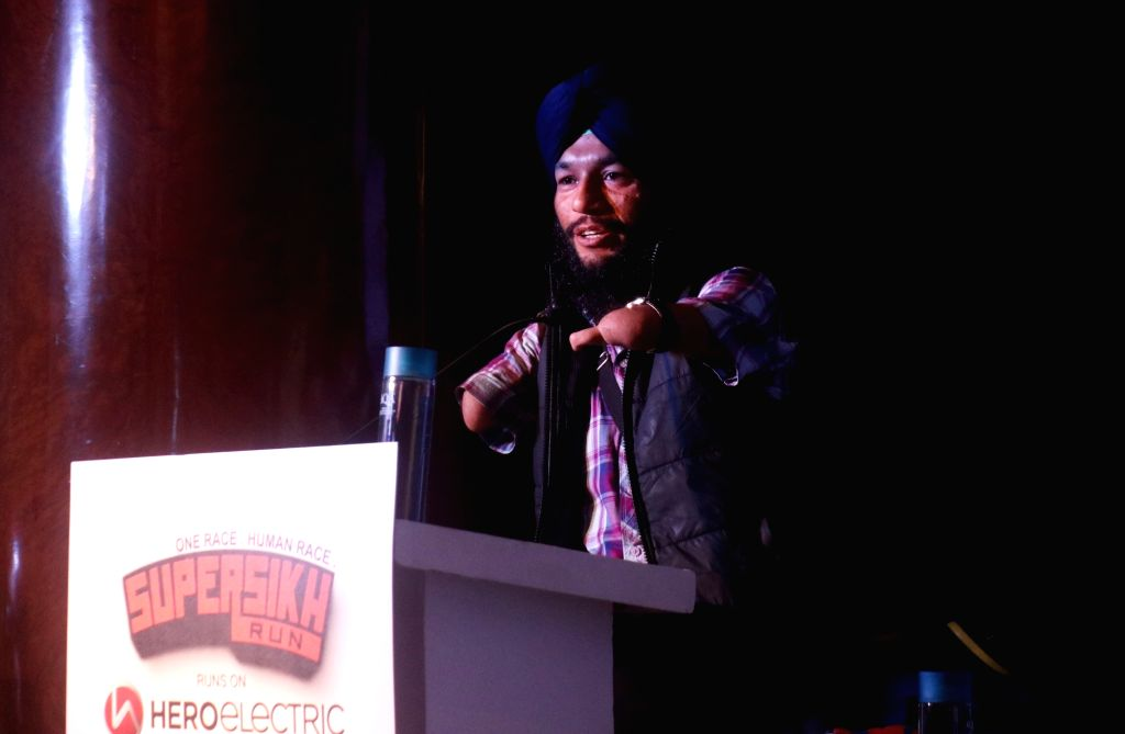 India's Armless cyclist Jagwinder Singh addresses during a press conference regarding the third edition of Super Sikh Run in New Delhi, on Nov 28, 2018. - Jagwinder Singh