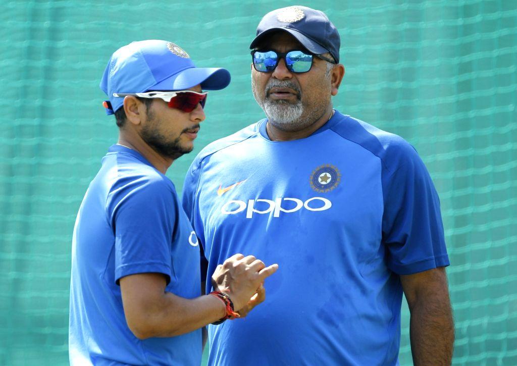 India's bowling coach Bharat Arun with Kuldeep Yadav during a practice session ahead of the second ODI match against Australia, at Vidarbha Cricket Association (VCA) Stadium, in Nagpur, on ... - Kuldeep Yadav