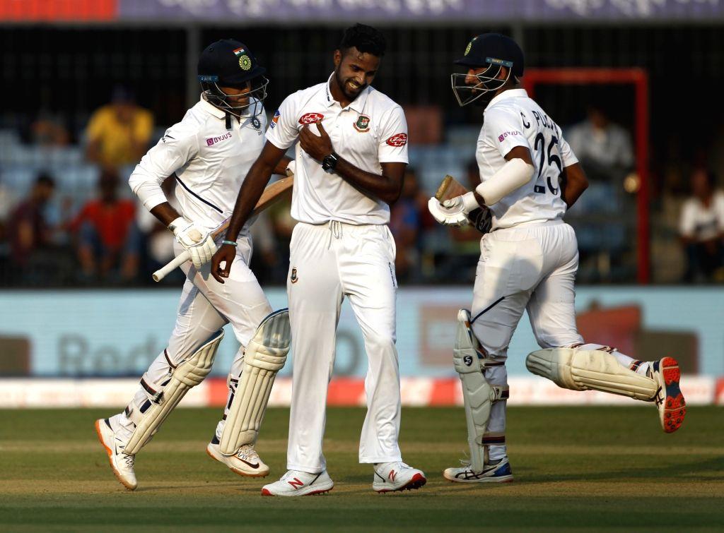 India's Cheteshwar Pujara and Mayank Agarwal on Day 1 of the 1st Test match between India and Bangladesh at Holkar Cricket Stadium in Indore, Madhya Pradesh on Nov 14, 2019.