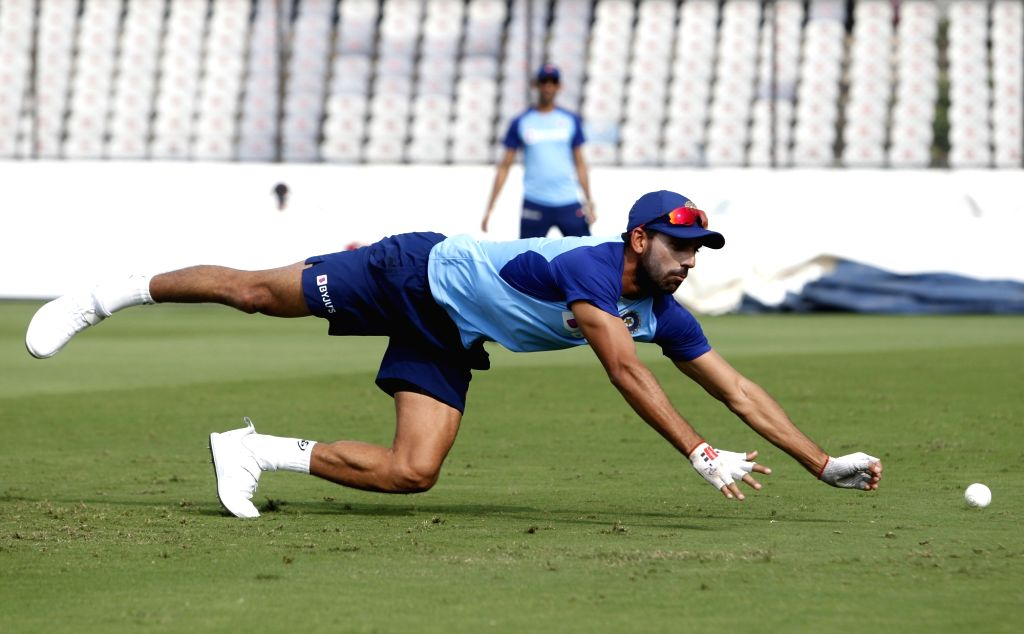 India's Deepak Chahar in action during a practice session ahead of the first Twenty20 match between India and West Indies at Rajiv Gandhi International Cricket Stadium in Hyderabad on Dec ...