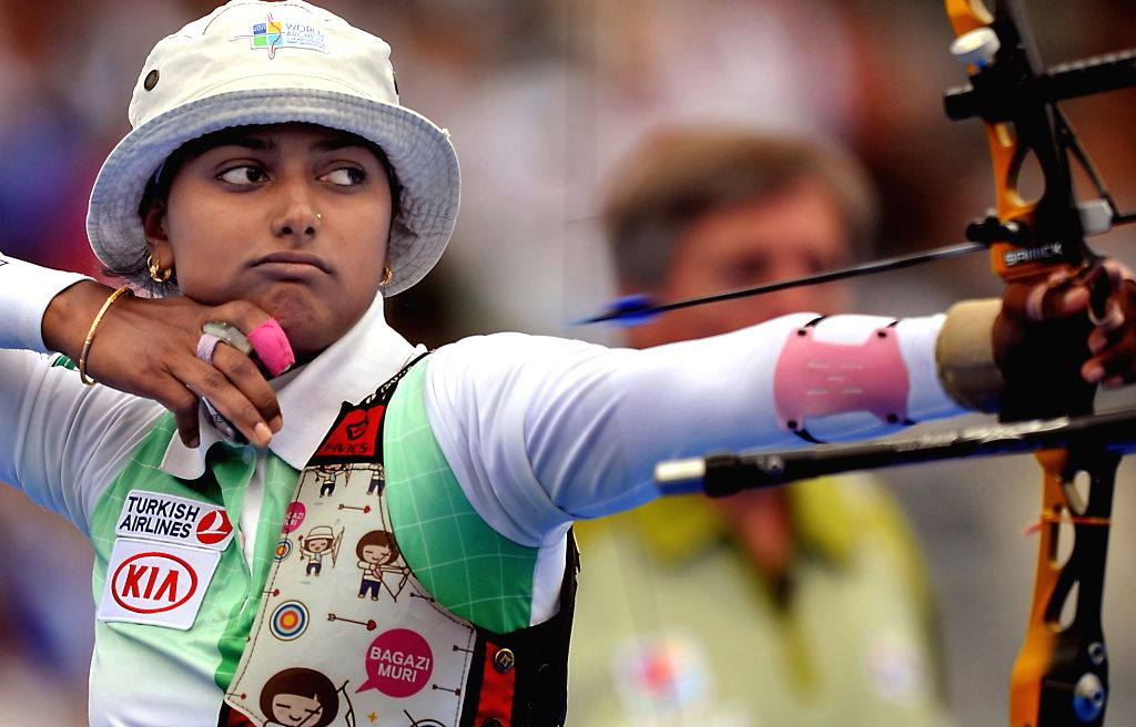 :  India's Deepika Kumari competes in the Women's Archery World Cup final match held at the Trocadero gardens in Paris on Sept. 22, 2013. Deepika Kumari ...