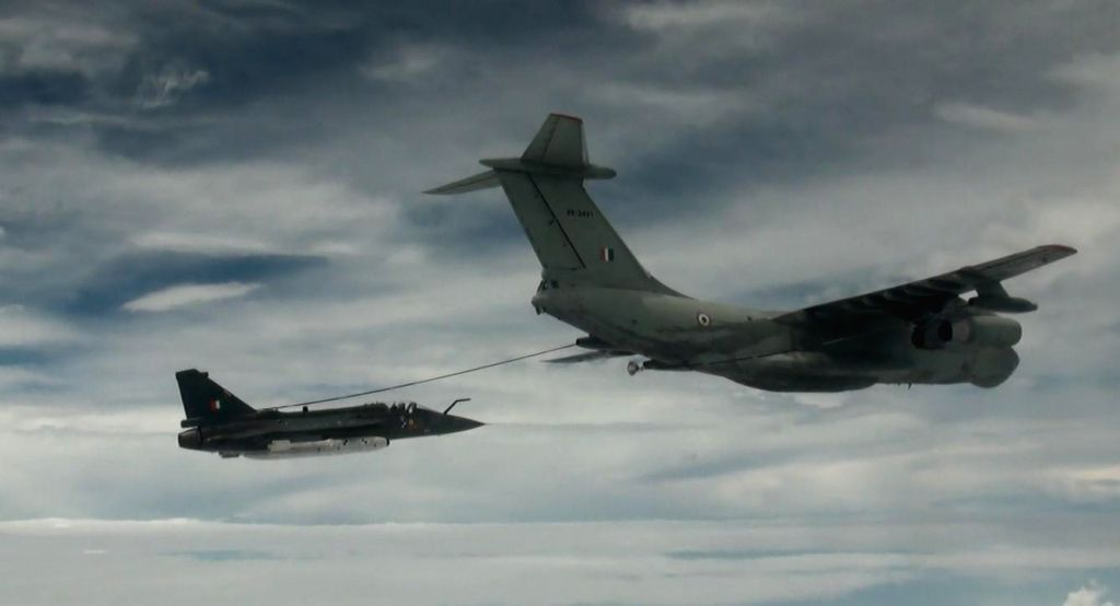 India's defence behemoth Hindustan Aeronautics Ltd (HAL) on Monday refuelled a Tejas fighter aircraft (left) midair at 20,000 ft through Russian Ilyushin-78 aerial refuelling tanker over Gwalior in ...