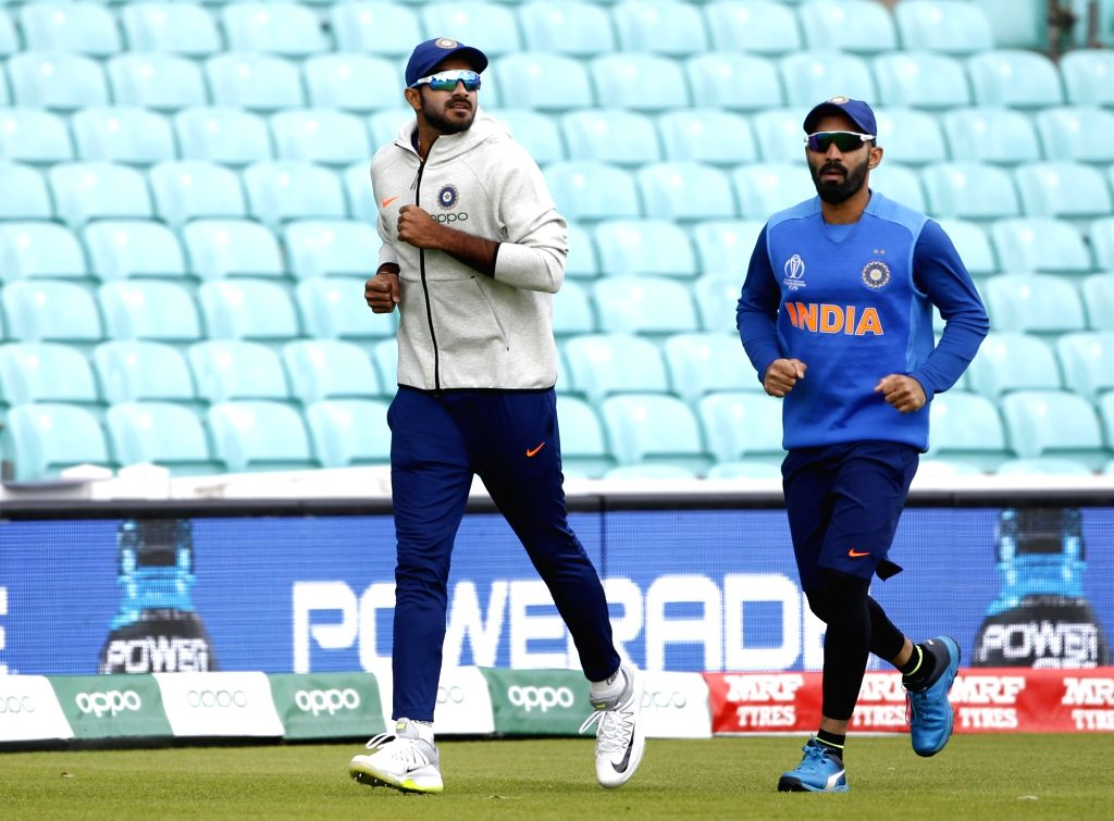 India's Dinesh Karthik and Vijay Shankar during a practice session ahead of their 2019 ICC Cricket World Cup match against Australia, at the Oval in London on June 8, 2019.