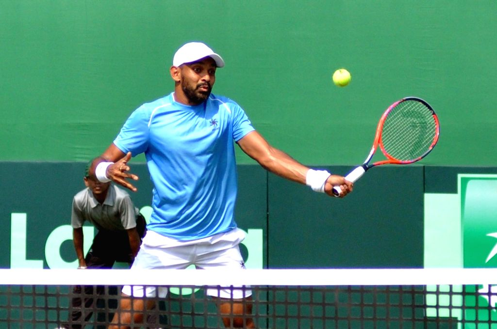 India's Divij Sharan in action against Italy's Matteo Berrettini and Simone Bolelli at the Davis Cup World Group doubles rubber in Kolkata on Feb. 2, 2019.