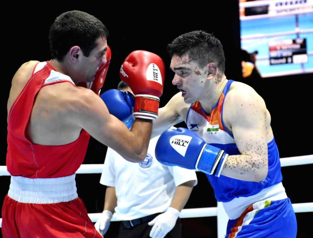India's Duryodhan Singh Negi and Armenia's Koryun Astoyan in action during the AIBA Men's World Championships Round 2 match in Ekaterinburg, Russia on Sep 13, 2019. - Duryodhan Singh Negi
