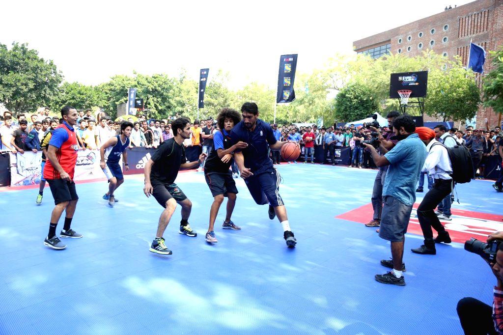 India`s first National Basketball Association (NBA) player Satnam Singh Bhamara during a basketball match at Lovely Professional University in Jalandhar on Oct 28, 2015.