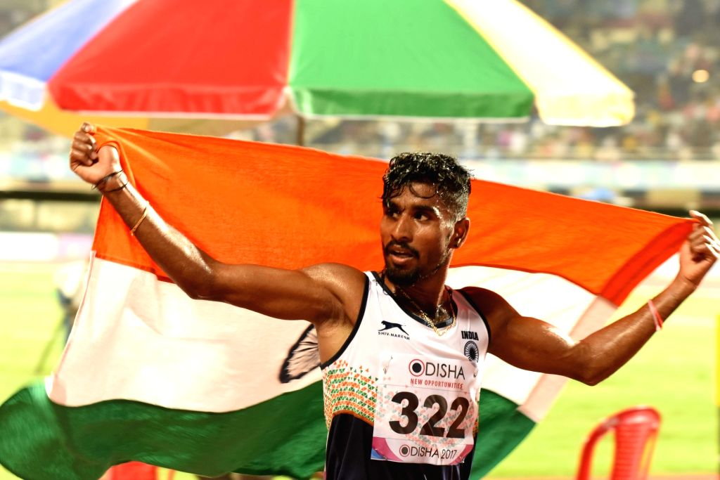 India's G Lakshmanan celebrates after winning gold in the men's 5000 meter event during Asian Athletics Championship at Kalinga Stadium in Bhubaneswar on July 6, 2017.