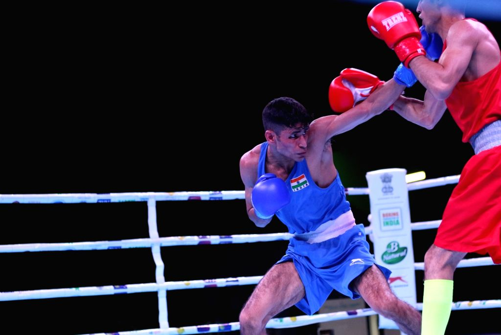 India's Gaurav Solanki in action against Russia's Maksim Chernyshev in the 56 Kg category in the quarter-final bout during Umakhanov Memorial International Tournament in Kaspiysk, Russia on ...