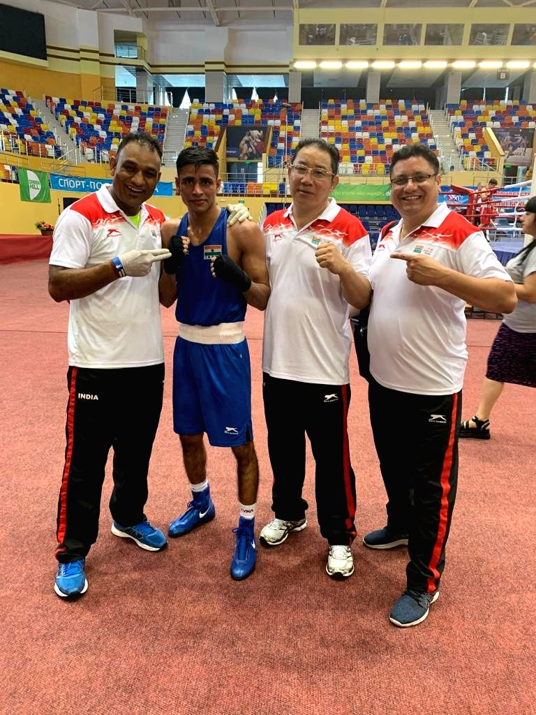 India's Gaurav Solanki who entered the semi-finals after defeating Russia's MaksimChernyshev in the 56 Kg category in the quarter-final bout during Umakhanov Memorial International ...