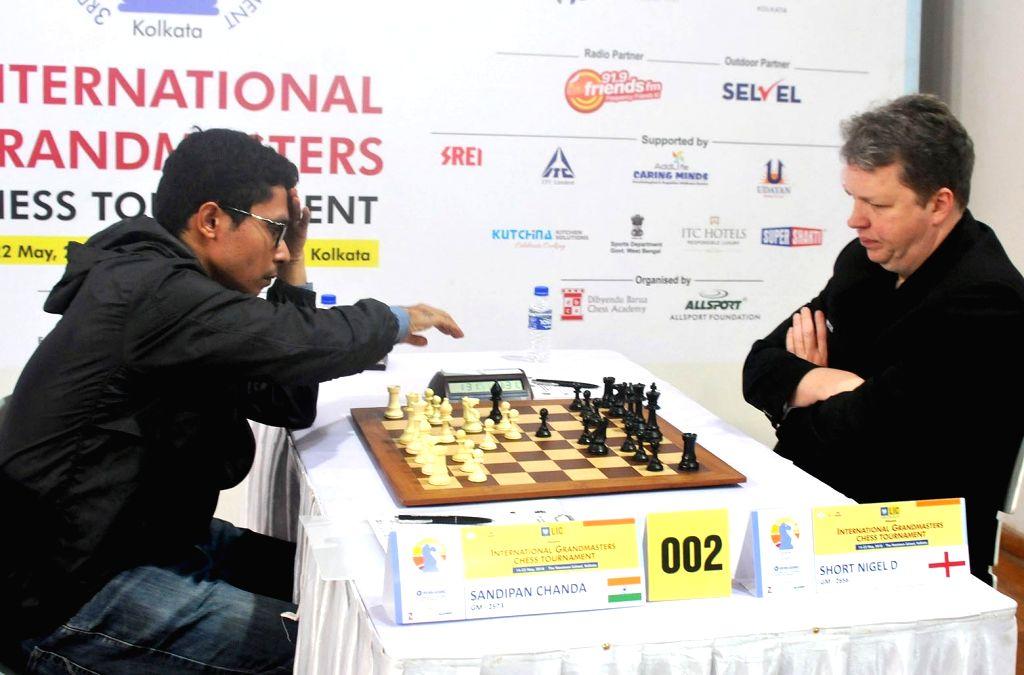 India's GM Sandipan Chanda with England's GM Short Nigel D at the 3rd Kolkata International Open Grandmasters Chess Tournament 2018 in Kolkata, on May 21, 2018.