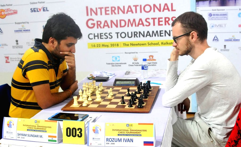 India's GM Shyam Sunder M (India) (L) with Russia's GM Rozum Ivan at the 3rd Kolkata International Open Grandmasters Chess Tournament 2018 in Kolkata, on May 21, 2018.