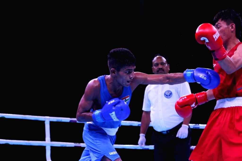 India's Govind Sahani in action against Tajikistan???s Shermukhammad Rustamov in the 49 Kg category in the quarter-final bout during Umakhanov Memorial International Tournament in Kaspiysk, ...