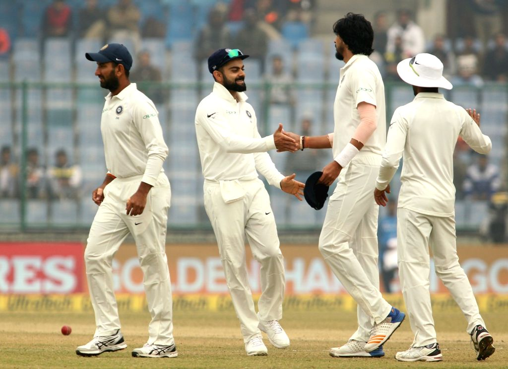 India's Ishant Sharma and Virat Kohli celebrate fall of a wicket of Sri Lanka's Dinesh Chandimal during Day 4 of the third test match between India and Sri Lanka at Feroz Shah Kotla ... - Ishant Sharma and Virat Kohli