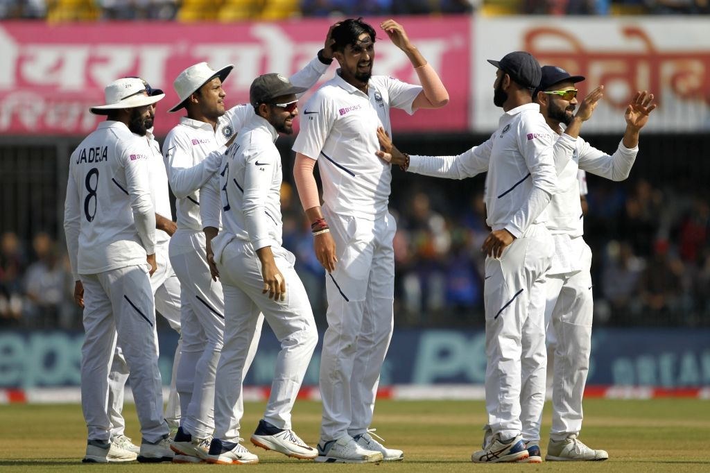 India's Ishant Sharma celebrates the wicket of  Shadman Islam with teammates during the 1st Test match between India and Bangladesh at Holkar Cricket Stadium in Indore, Madhya Pradesh on Nov ... - Ishant Sharma