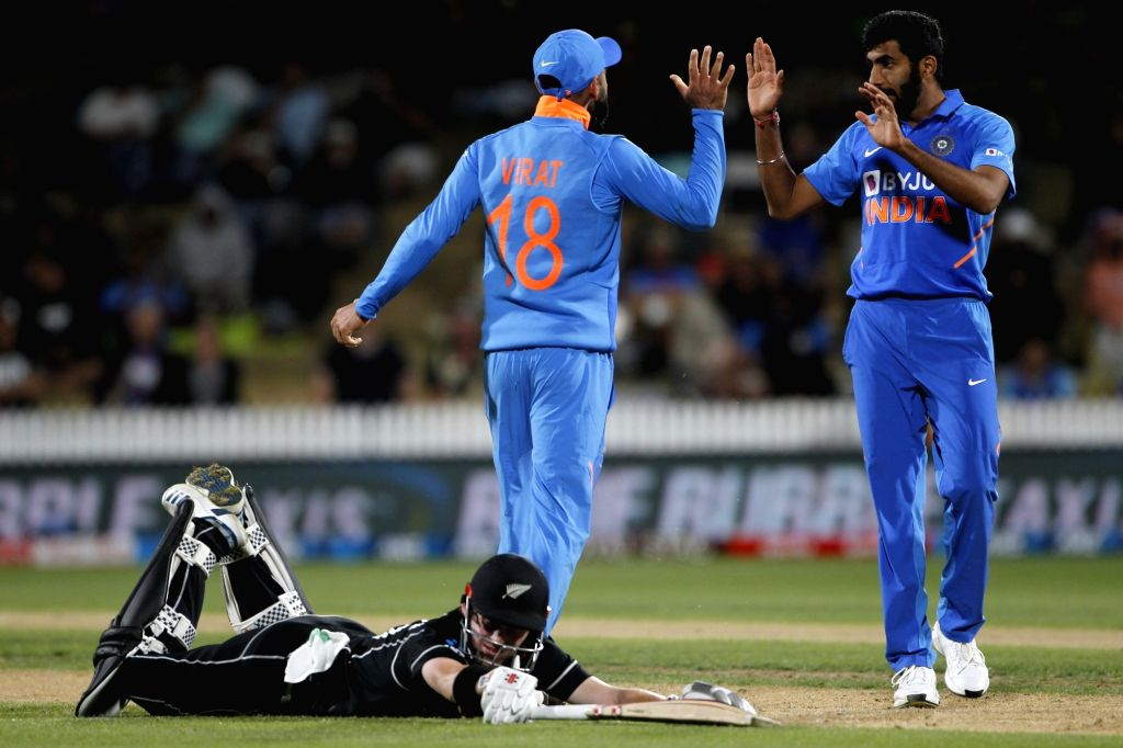India's Jasprit Bumrah and Virat Kohli celebrate the wicket of Henry Nicholls during the 1st ODI of the three-match series between India and New Zealand at the Seddon Park in Hamilton, New ... - Virat Kohli