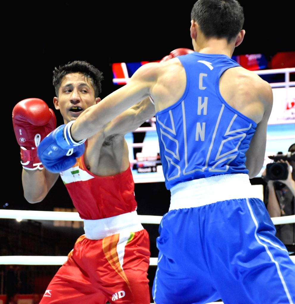 India's Kavinder Singh Bisht and China's Chen Zhihao in action during the AIBA Men's World Championships Round 2 match in Ekaterinburg, Russia on Sep 15, 2019. - Kavinder Singh Bisht