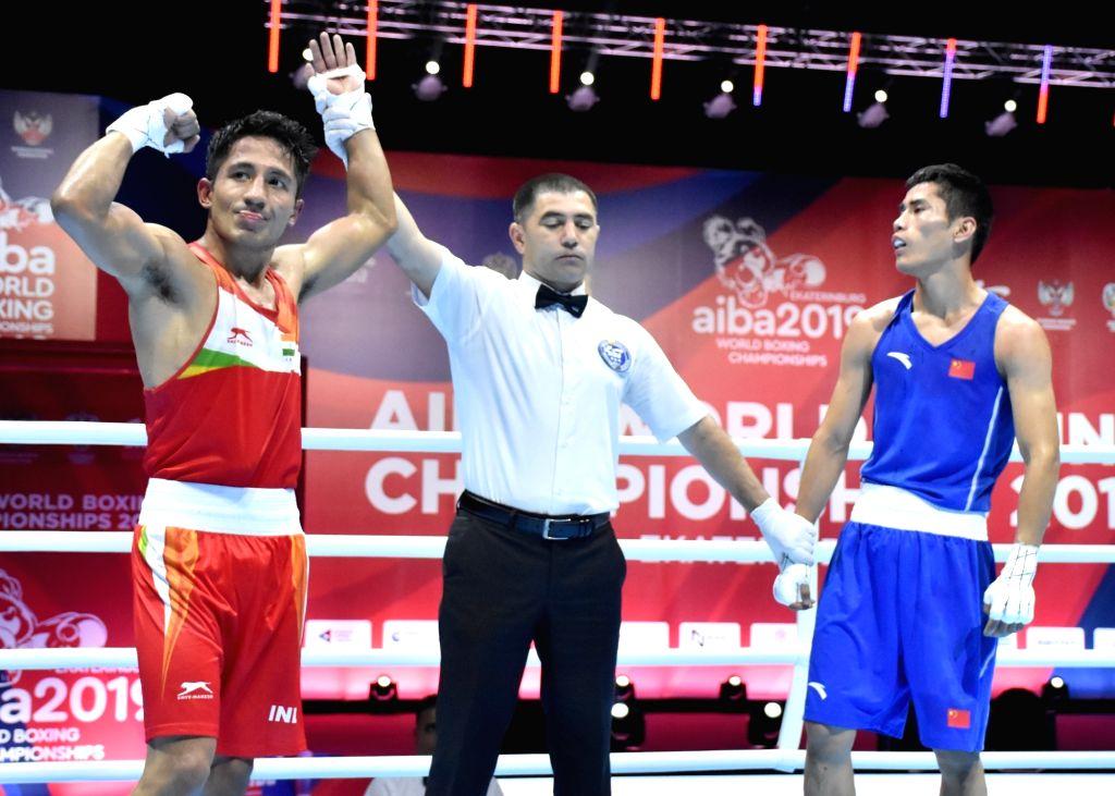 India's Kavinder Singh Bisht celebrates during the AIBA Men's World Championships Round 2 match in Ekaterinburg, Russia on Sep 15, 2019. - Kavinder Singh Bisht