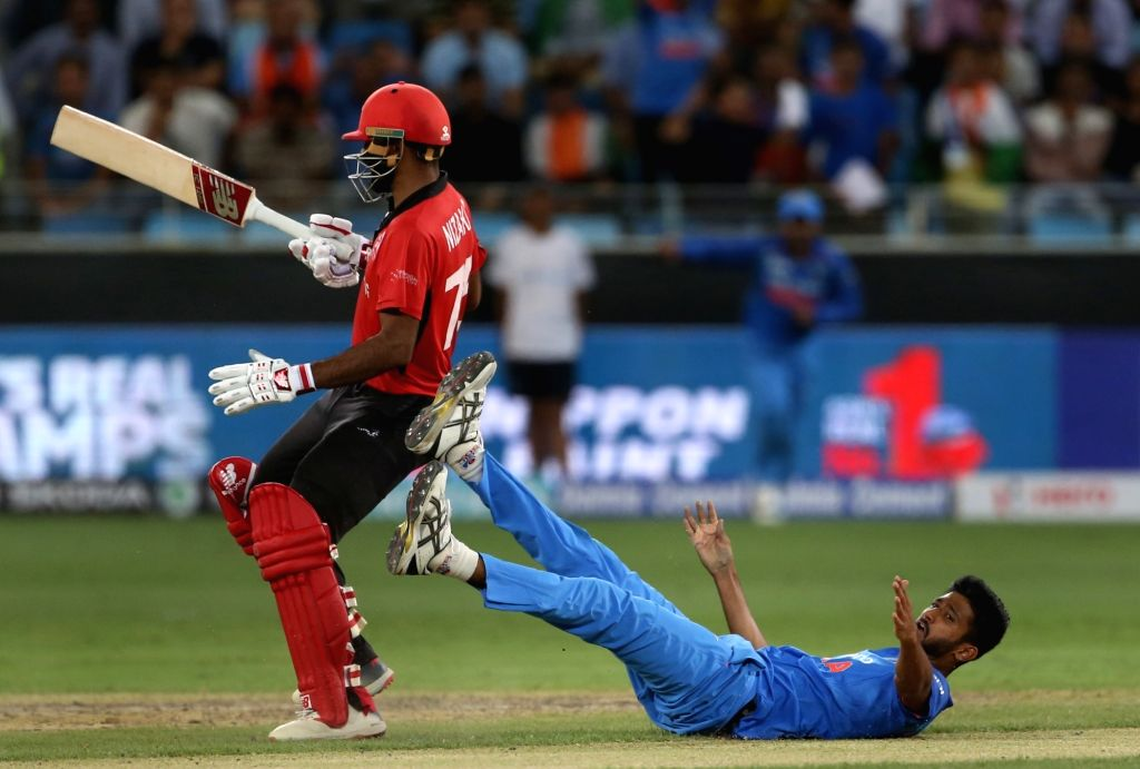 India's Khaleel Ahmed during the fourth match (Group A) of Asia Cup 2018 between Hong Kong and India at Dubai International Cricket Stadium on Sept 18, 2018.