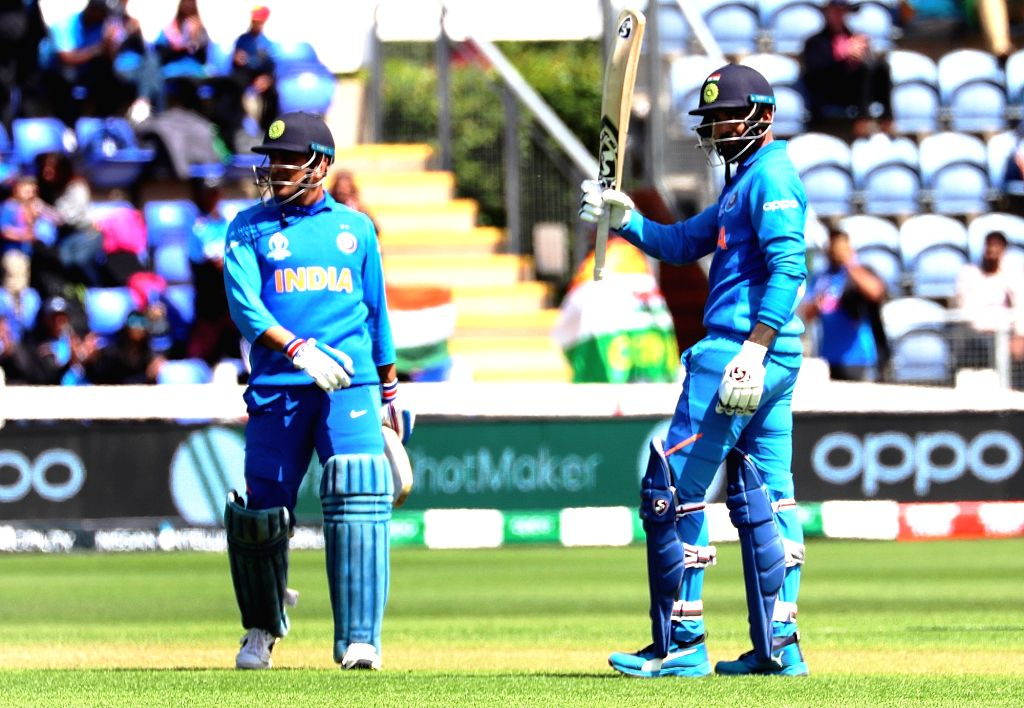 India's KL Rahul celebrates his century during the second warm-up match between India and Bangladesh at the Sophia Gardens in Cardiff, Wales on May 28, 2019. Also seen India's MS Dhoni. - MS Dhoni
