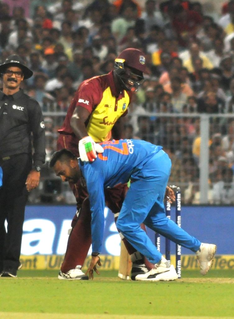 India's Krunal Pandya and West Indies' Carlos Brathwaite during the first T20 International match between Indian and West Indies at the Eden Gardens in Kolkata, on Nov 4, 2018.