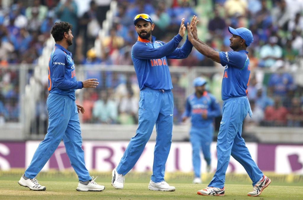 India's Kuldeep Yadav along with skipper Virat Kohli celebrates fall of a wicket during the fifth and final ODI match between India and West Indies in Thiruvananthapuram, on Nov. ... - Kuldeep Yadav and Virat Kohli