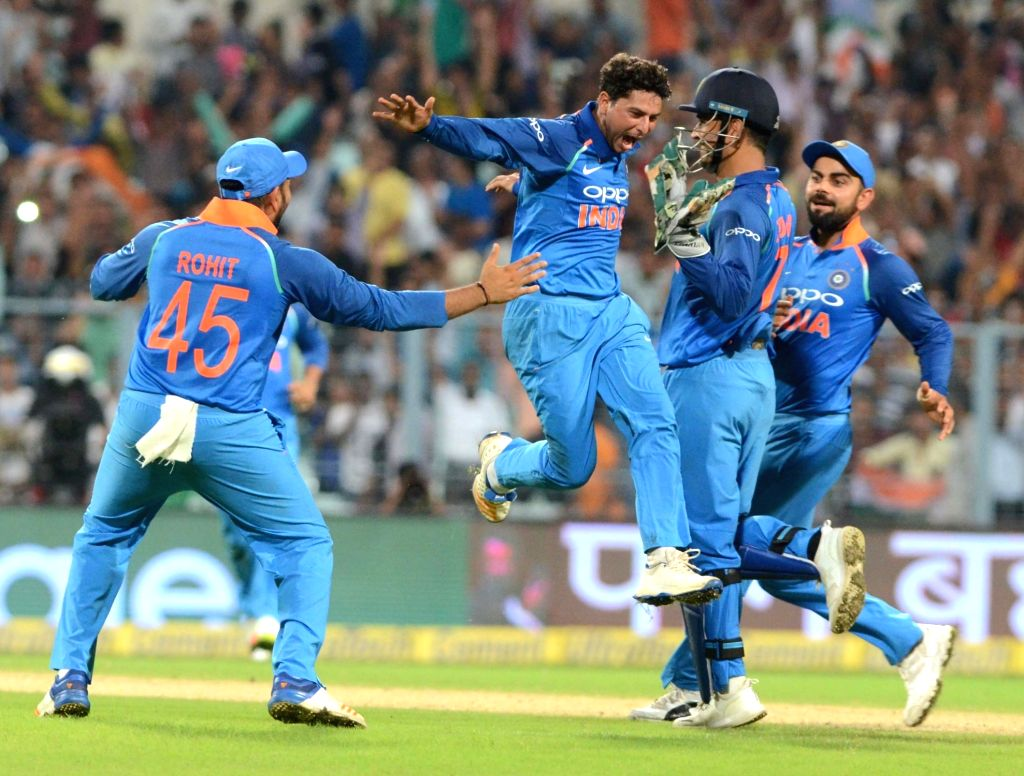 India's Kuldeep Yadav celebrates as he gets his first hat-trick during the second ODI cricket match between India and Australia at Eden Gardens in Kolkata on Sept 21, 2017. - Kuldeep Yadav