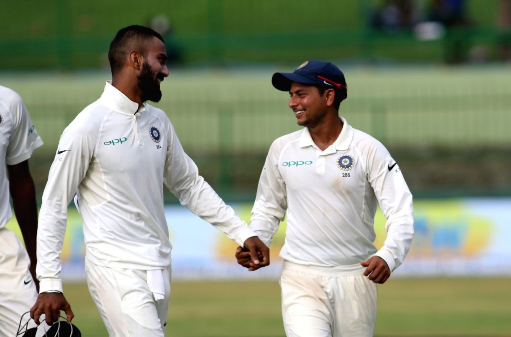 India's Kuldeep Yadav, center, shares a laugh with teammates  as they leave the ground at the end Day 2 of the third test match between India and Sri Lanka at Pallekele International ... - Kuldeep Yadav