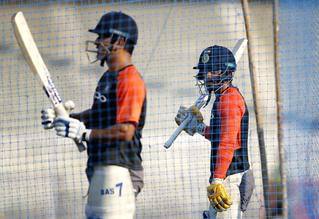 India's M.S. Dhoni and Kedar Jadhav during a practice session ahead of the fourth ODI match against West Indies, at Cricket Club of India in Mumbai, on Oct 28, 2018.