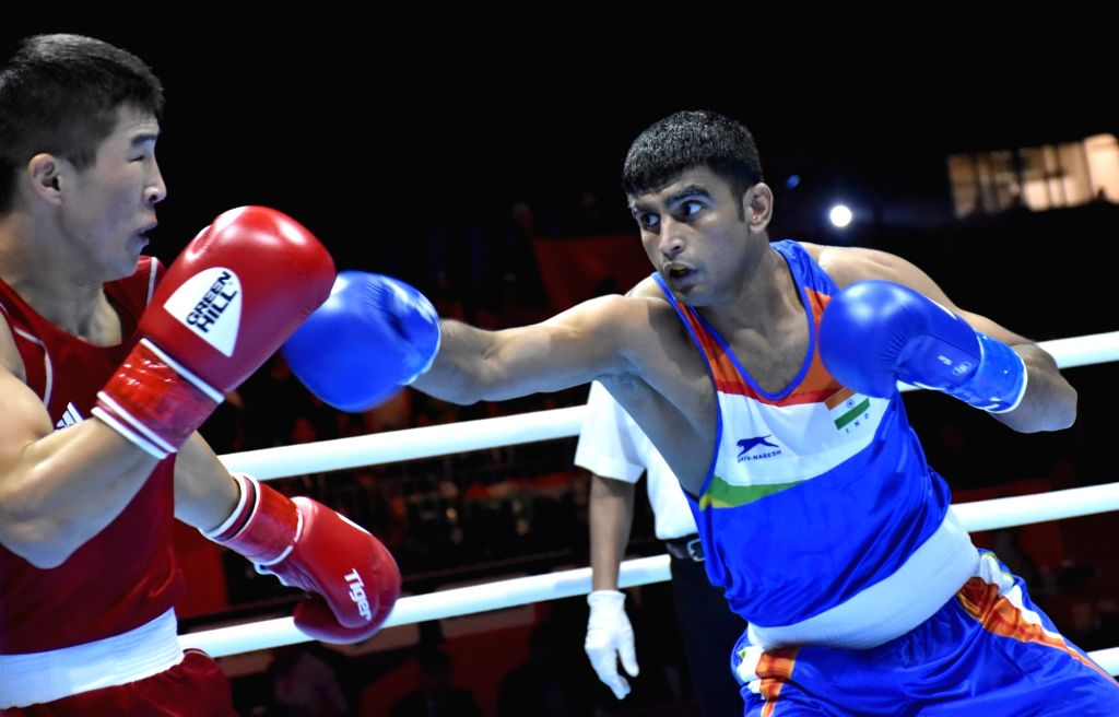 India's Manish Kaushik and Kyrgyzstan's Argen Ullu Kadyrbek in action during the AIBA Men's World Championships Round 1 debut match in Ekaterinburg, Russia on Sep 12, 2019.