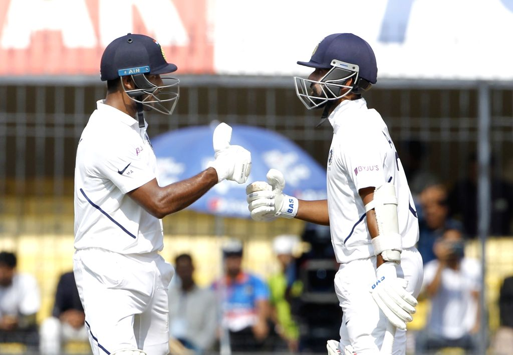 India's Mayank Agarwal celebrates his 150 runs with teammate Ajinkya Rahane on Day 2 of the 1st Test match between India and Bangladesh at Holkar Cricket Stadium in Indore, Madhya Pradesh on ...