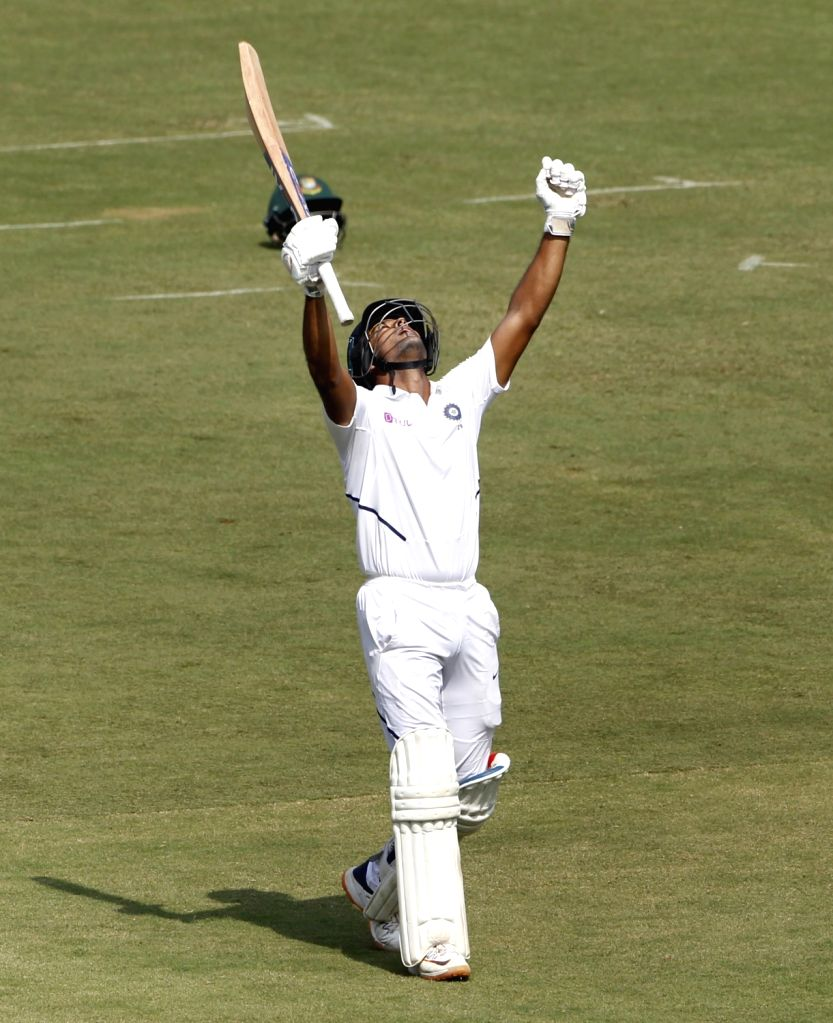 India's Mayank Agarwal celebrates his century on Day 2 of the 1st Test match between India and Bangladesh at Holkar Cricket Stadium in Indore, Madhya Pradesh on Nov 15, 2019.