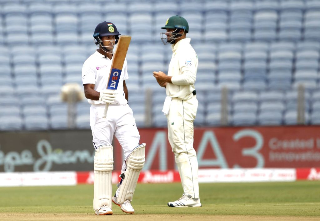 India's Mayank Agarwal celebrates his half century on Day 1 of the second Test match between India and South Africa at Maharashtra Cricket Association Stadium in Pune, on Oct 10, 2019.