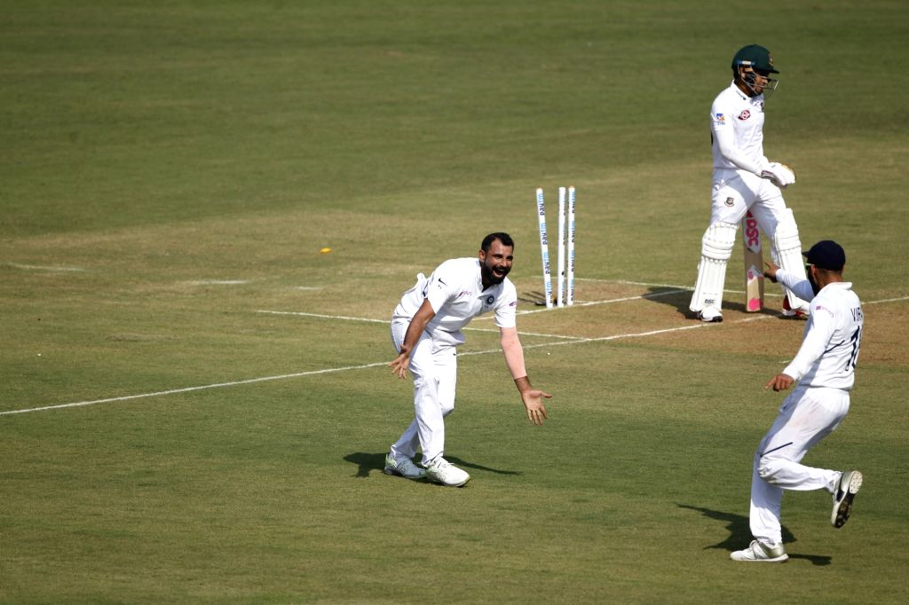 India's Mohammed Shami celebrates fall of Mushfiqur Rahim's wicket on Day 1 of the 1st Test match between India and Bangladesh at Holkar Cricket Stadium in Indore, Madhya Pradesh on Nov 14, ...