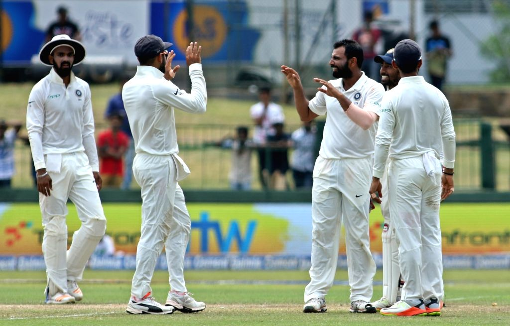 India's Mohammed Shami celebrates the dismissal of Sri Lanka's Niroshan Dickwella with teammates on Day 3 of the second test match between India and Sri Lanka at Sinhalese Sports Club Ground ...