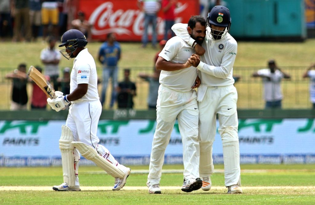 India's Mohammed Shami celebrates the dismissal of Sri Lanka's Rangana Herath with teammates on Day 3 of the second test match between India and Sri Lanka at Sinhalese Sports Club Ground in ...