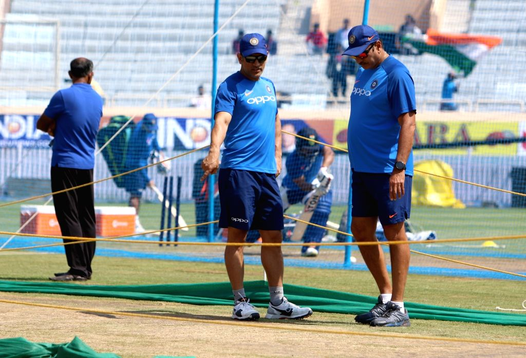 India's MS Dhoni and coach Ravi Shastri during a practice session ahead of the third ODI match against Australia, in Ranchi, on March 7, 2019. - MS Dhoni