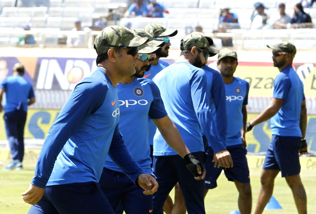 India's MS Dhoni dons a camouflage cap during the third ODI match against Australia at JSCA International Stadium Complex in Ranchi on March 8, 2019. 'Men in Blue' are wearing the camouflaged ... - MS Dhoni