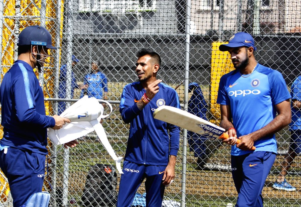 India's MS Dhoni, Yuzvendra Chahal and Vijay Shankar during a practice session at Basin Reserve cricket stadium in Wellington, New Zealand on Feb. 2, 2019. - MS Dhoni