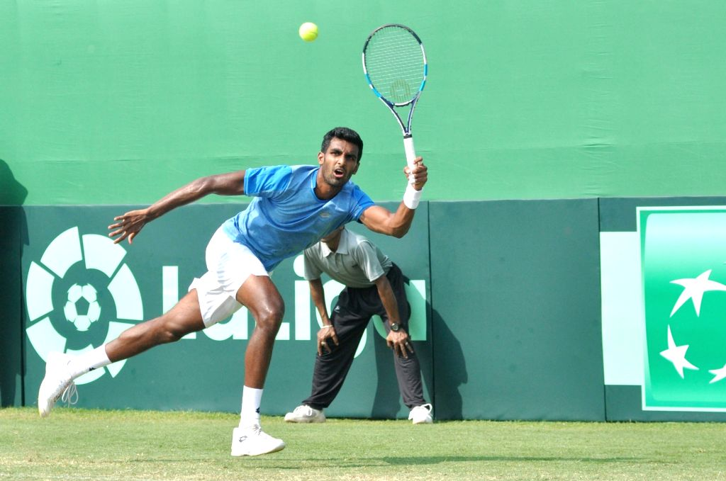 India's Prajnesh Gunneswaran in action against Italy's Andreas Seppi at the Davis Cup World Group qualifier tie in Kolkata on Feb. 2, 2019.