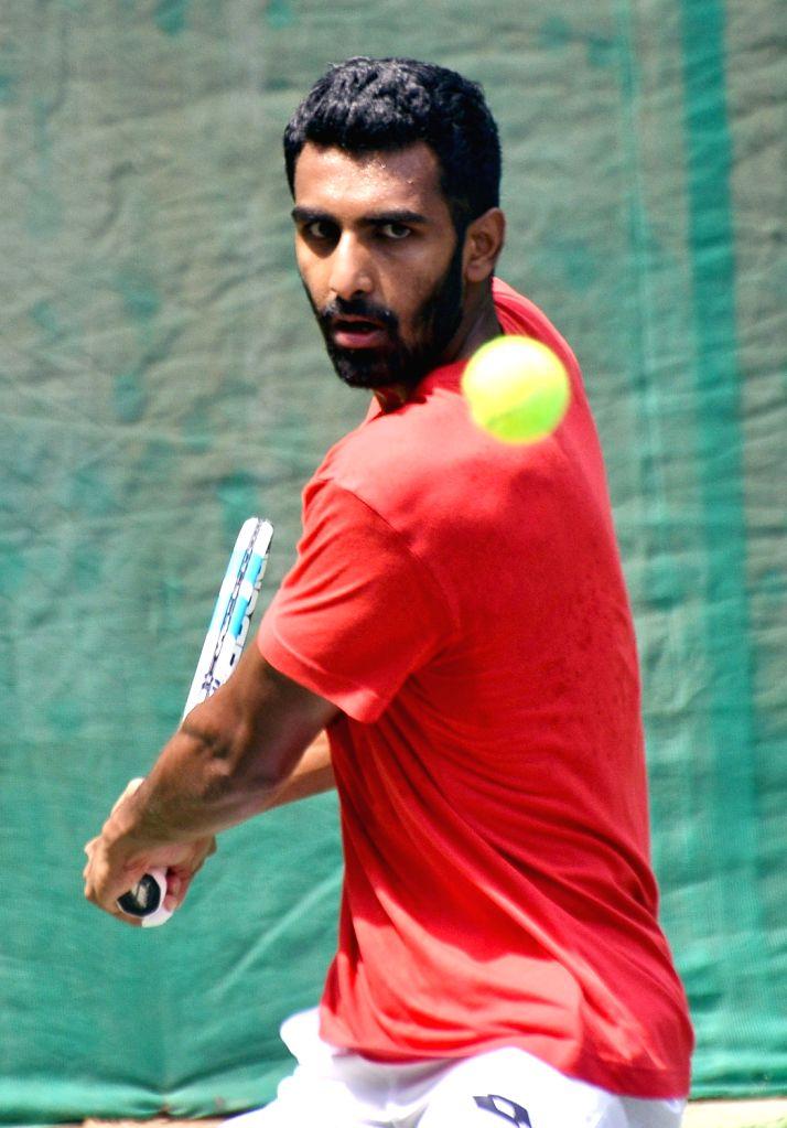 India's Prajnesh Gunneswaran in action during a Bengaluru Tennis Open 2020 match at Karnataka State Lawn Tennis Association tennis court in Bengaluru on Feb 9, 2020.