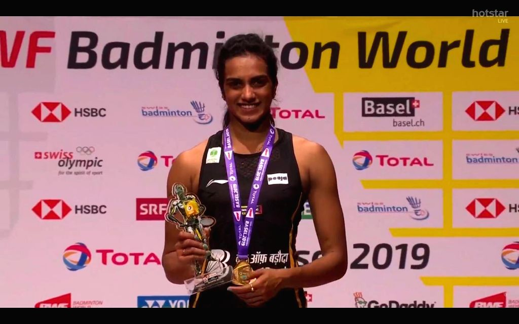 India's PV Sindhu poses on the podium during the awarding ceremnoy after the women's singles final match against Japan's Okuhara Nozomi at the BWF Badminton World Championships 2019 in Basel, ...